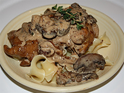 Chicken, Caramelized Onions, and Wild Mushrooms Over Pappardelle Sauced With A Creamy Bacon-Thyme-Balsamic Reduction